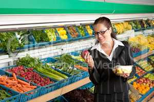 Grocery store shopping - Business woman holding apple