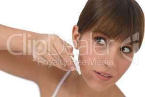 Body care - Female teenager cleaning face