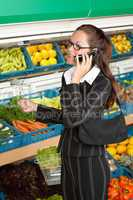 Grocery store shopping - Business woman with mobile phone