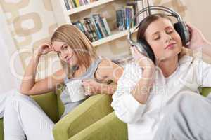 Students - Two female teenager relaxing in lounge