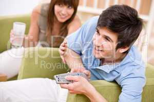 Student - happy teenager holding remote control