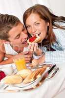 Young happy couple having luxury breakfast