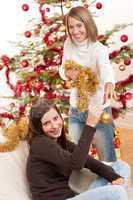Two smiling women with Christmas decoration