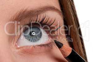 Blue eye, woman applying black make-up pencil