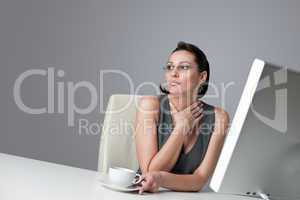 Thoughtful business woman at office with coffee
