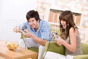 Student - happy teenagers playing video game having fun