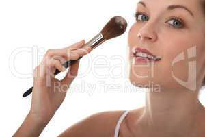 Body care series - Beautiful young woman applying powder