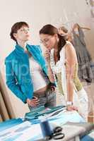 Fashion model trying jacket in designer studio