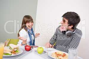 Student cafeteria - teenage couple having fun during lunch break