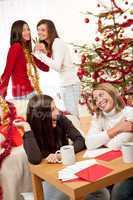 Four young women having fun on Christmas