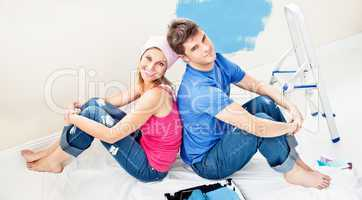 couple relaxing after painting a room