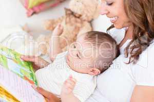 Joyful mother with baby