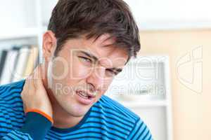 man having a neckhache