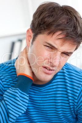 man having a neckache