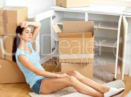woman sitting on the floor after unpack