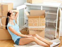 woman sitting on the floor after unpacking