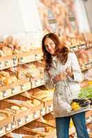 Grocery store: Young woman in bakery department