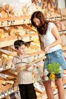 Grocery store shopping - Mother with child buying bread