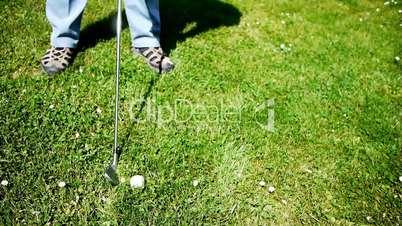 Golf - Man Hit Ball on Meadow