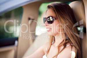 woman driving car with sunglasses on