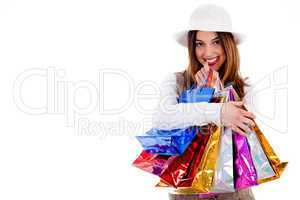 Young lady happy with lot of shopping bags
