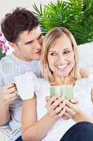 man and girlfriend drinking coffee
