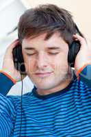 man listening music closing his eyes