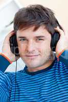 man listening music using headphones