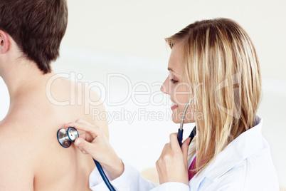 female doctor using stethoscope
