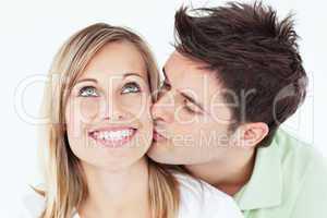 man kissing his smiling girlfriend
