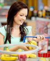 woman buying bananas and apples