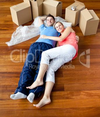 Young couple lying on floor