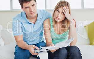 couple after calculating bills