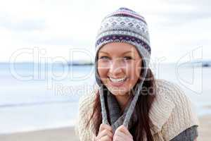 Young smilng female wearnig hat