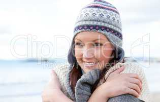 Pretty woman is cold wearing ha