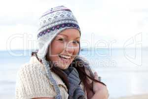 woman is cold and wearing a hat
