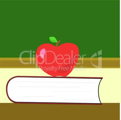 Apfel auf Buch