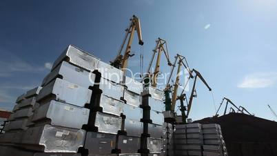 Steel containers and loading cranes