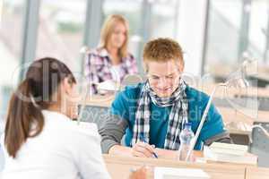 Three high school students in classroom