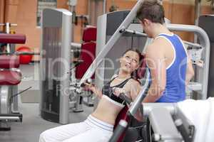 woman sitting on a shoulder press