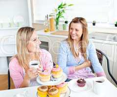 Female friends with cakes and coffee