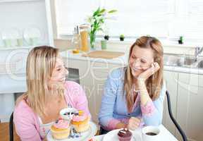 women eating cupcakes and drinking coffee