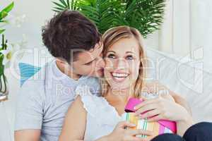 man and girlfriend after giving her a present