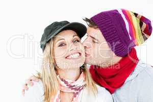 woman receiving a kiss from her boyfriend