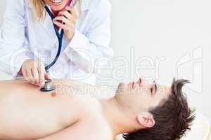 doctor feeling the breathing of a patient