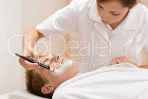 Male cosmetics - facial mask in salon