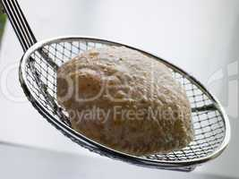 Deep Fried Puff Bread on a Strainer