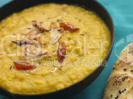 Bowl of Tarka Dal with Naan Bread