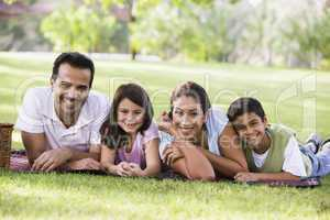 couple having picnic in the park with their kids