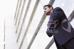 Businessman standing outside modern office